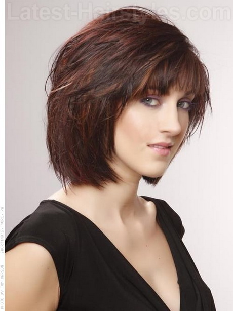 Layered Brunette Shag Chin-Length Haircut with Red Highlights