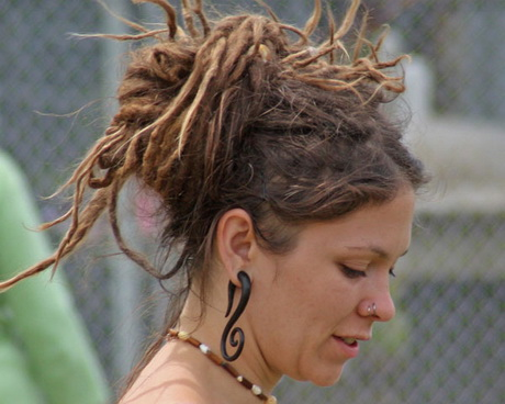 Long dreadlocks are kept out-of-the-way and given an elegant ...