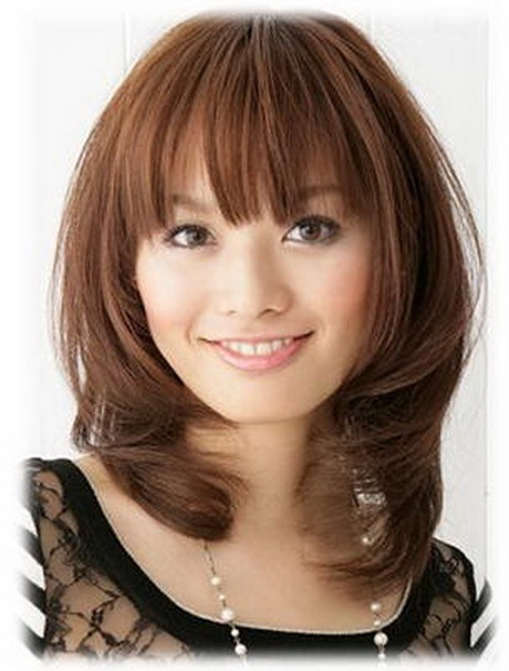 Haircuts medium length with bangs