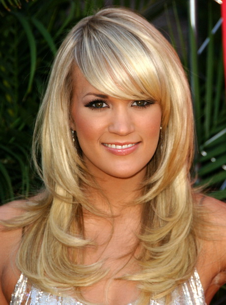 Layered haircut with side swept bangs