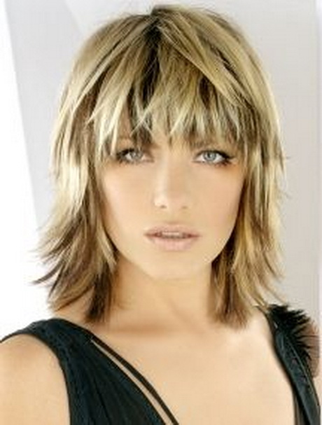Blonde medium length choppy shag haircut with wispy bangs and dark ...