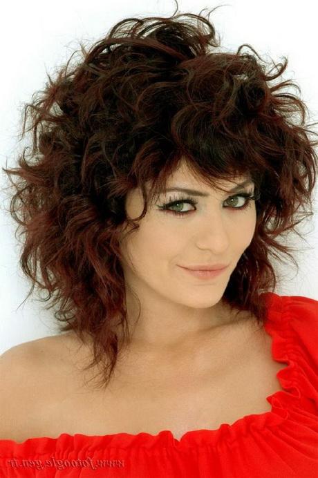 Medium length curly haircuts with bangs