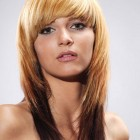 Pictures of layered haircuts with bangs