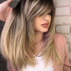Haircuts for long thick hair with side bangs