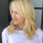 Mid length layered hair with bangs