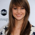 Long layered haircuts with side fringe