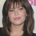 Medium length hair with bangs for round faces