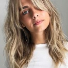 Layered haircut with bangs for medium length hair