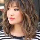 Medium layered hair with bangs